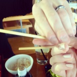 Brian teaching me the proper chopstick technique